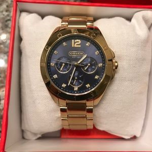Gold and navy blue authentic Coach watch.